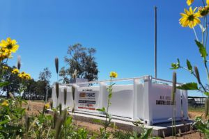 10000l self bunded tank on the farm, flowers, blue sky